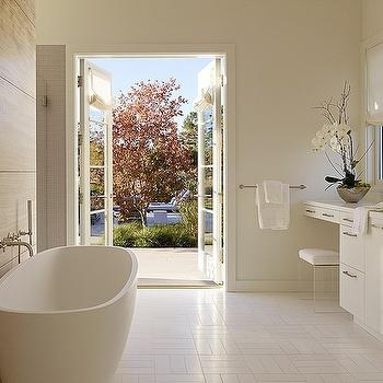 Egg Shaped Tub In Front Of White Marble Tiled Accent Wall