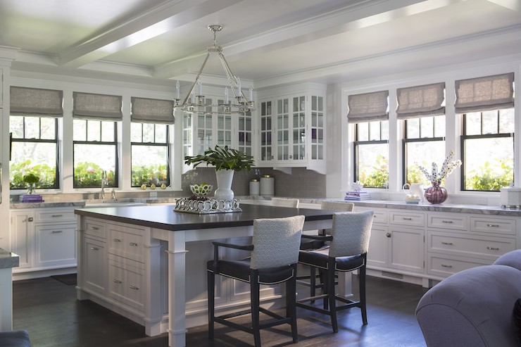 Stunning Kitchen With Round Flatline Chandelier Hung From Coffered Ceilings  Over An Extended Kitchen Island With Honed Black Counter Lined With Leather  ...