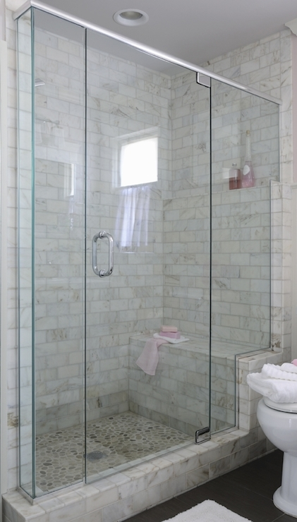 Glass front shower design ideas large walk in shower with marble subway tiled surround accented with a built in ledge over shower bench atop pebble shower floor finished with pink accents planetlyrics Choice Image