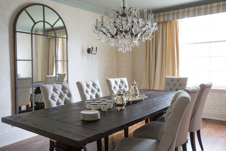 View Full Size Sophisticated Dining Room Features Crystal Chandelier Over Reclaimed Wood Trestle Table Surrounded By Light