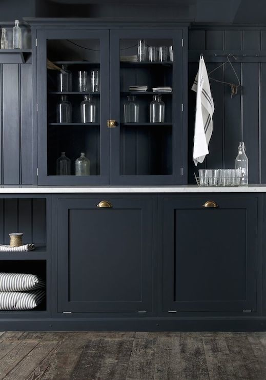 Navy kitchen cabinets transitional laundry room for Flat black kitchen cabinets