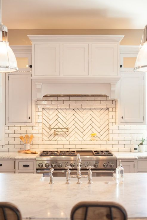 Herringbone cooktop backsplash transitional kitchen Italian marble backsplash