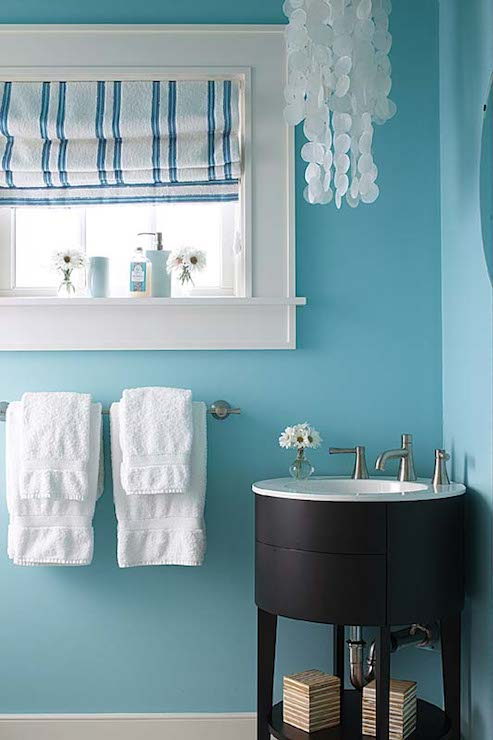 White And Turquoise Powder Room Features A Round Espresso Corner Vanity Framed By Bright Blue Walls Illuminated Tiered Capiz Chandelier