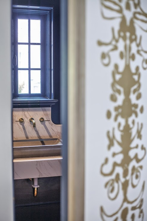 Navy Blue Powder Room With Marble Vanity And Gold Sink