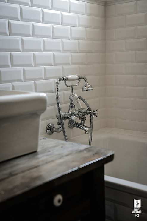 Gorgeous Bathroom Features Drop In Tub Accented With White Beveled Subway Tile Surround And Vintage Shower Kit Beside An Overmount Sink Atop A Reclaimed