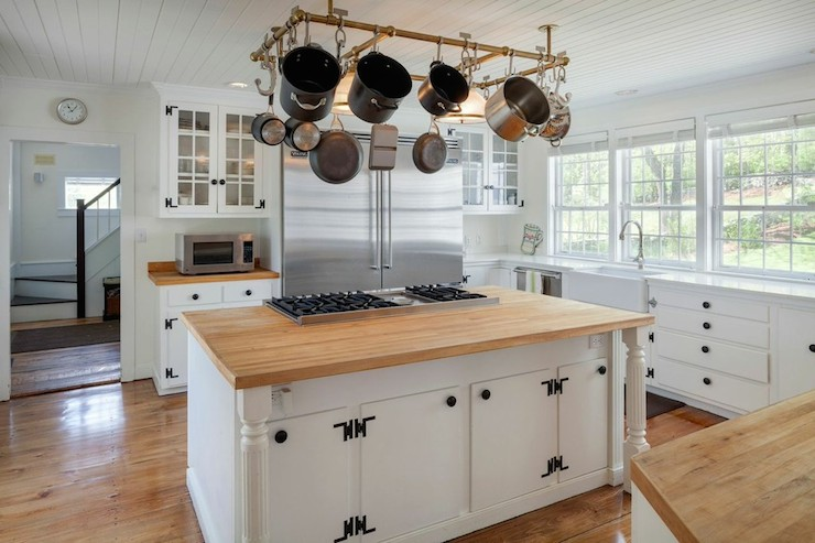 view full size. Renee Zellweger - Cottage kitchen features white cabinets  adorned with exposed hinges ...