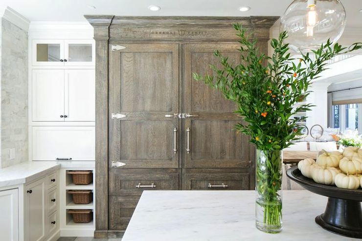 White And Gray Kitchen Features A Built In Refrigerator And Freezer Drawers  Concealed Behind Gray Wash Cabinet Doors And Drawers Beside White Built In  ...