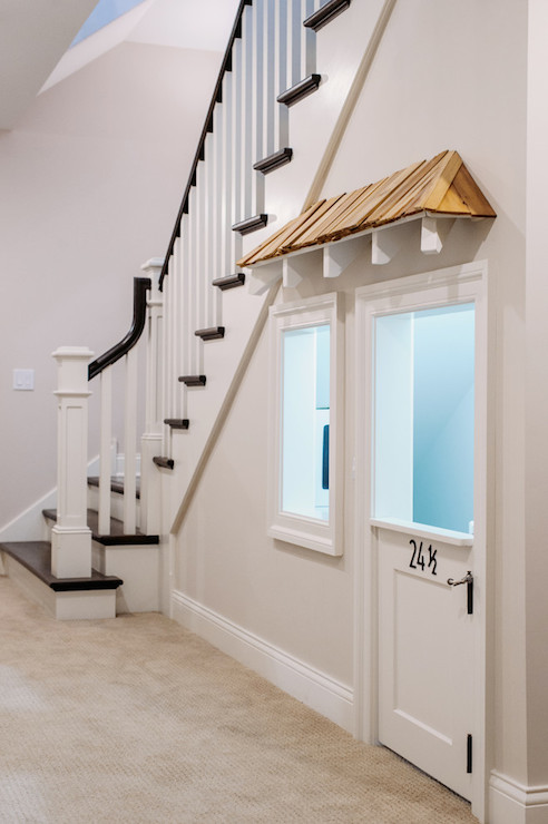 hidden closet door ideas - Under The Stairs Playroom Transitional entrance foyer