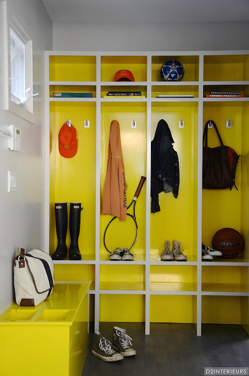 Modern Mud Room Boasts Built In Lockers, One For Each Family Member,  Featuring Cubby Storage And Bench Seating Painted Glossy Yellow With White  Trim Atop ...