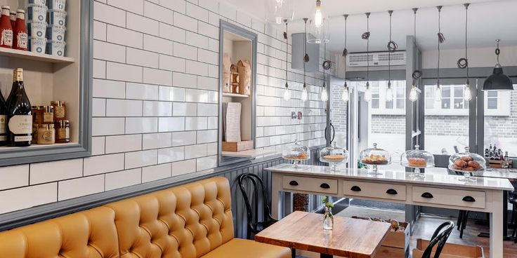 Bistro style kitchen boasts subway tiled walls highlighted by dark gray  grout accented with tiled niches over gray beadboard clad lower walls which  frame a ...