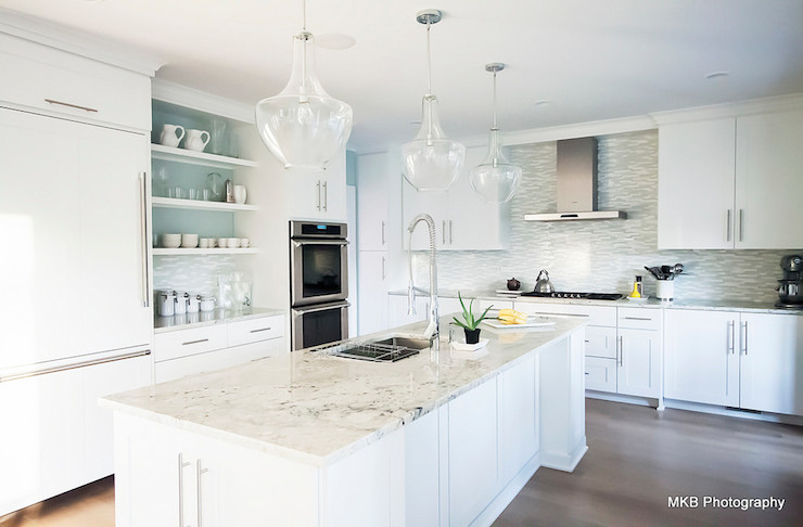 Beautiful kitchen features white shaker cabinets accented with brushed  nickel hardware alongside bianco romano granite counters and a linear gray  glass. Bianco Romano Granite   Transitional   kitchen   Benjamin Moore