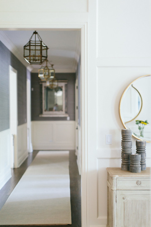 Chic hallway is dotted with Suzanne Kasler Morris Lanterns as well as ...