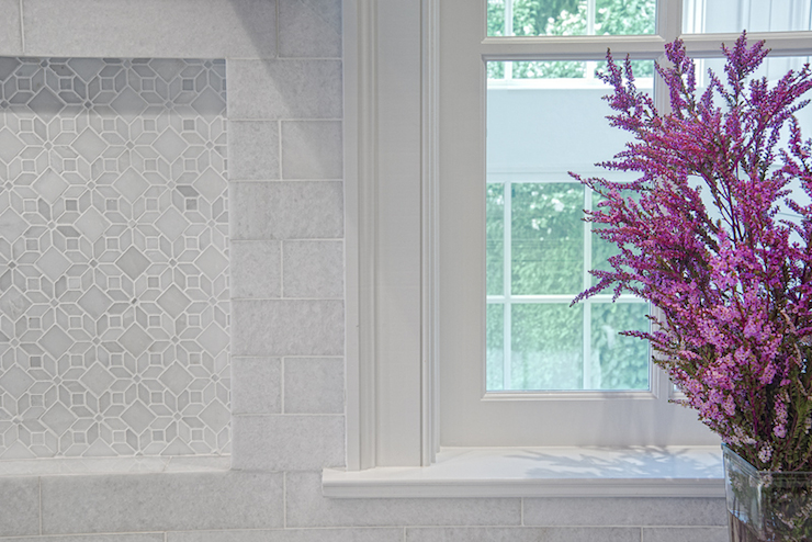 Kitchen Boasts Marble Subway Tiled Backsplash Accented With Geometric Marble Tiled Niche