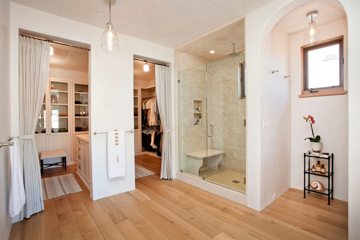 Beautiful Bathroom Features A Walk In Shower Filled With Linear Tiled  Surround As Well As Freestanding Shower Bench Under Rain Shower Head Beside  Arched ...