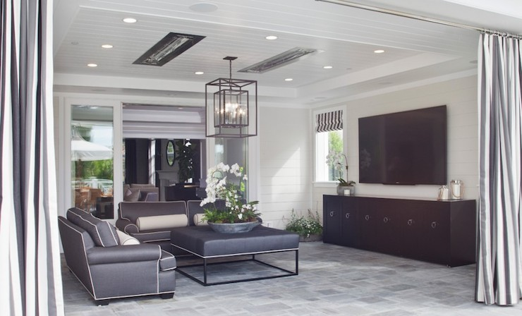 Black And White Striped Outdoor Curtains Open To Reveal A Contemporary  Covered Patio Featuring Glossy White Beadboard Ceiling Dotted With Pot  Lighting And ...