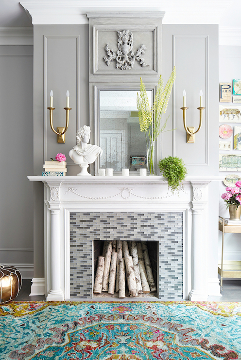 Fabulous Living Room Features Traditional Fireplace Mantel Accented With  Linear Glass Glass Mosaic Tile Surround Illuminated By Studio French Deco  Horn ...