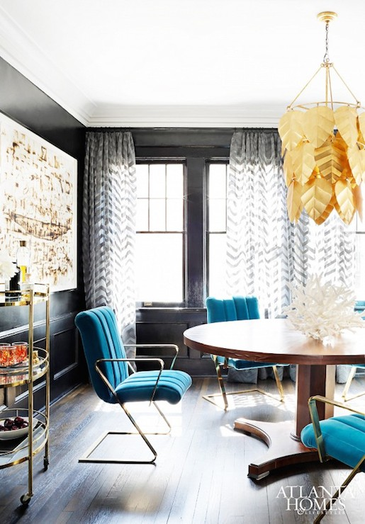 Eclectic Dining Room Features Black Wainscoting And Walls Framing Sash Windows Dressed In Sheer Gray Chevron Drapes Which Frame A Traditional Pedestal