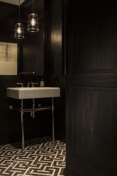 Powder room with black and white geometric floor tiles for Black floor white walls bathroom