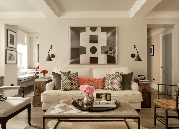 Beautiful Living Room Boasts Art Over A White Linen Sofa With Two Cushions  Adorned With Dark Gray Velvet Pillows, Gray Geometric Pillows And A Pink ...