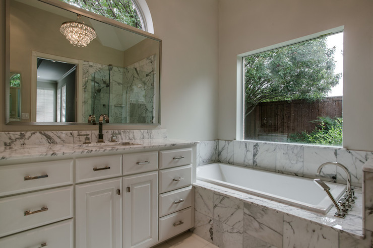 Marble Tiled Tub Transitional Bathroom