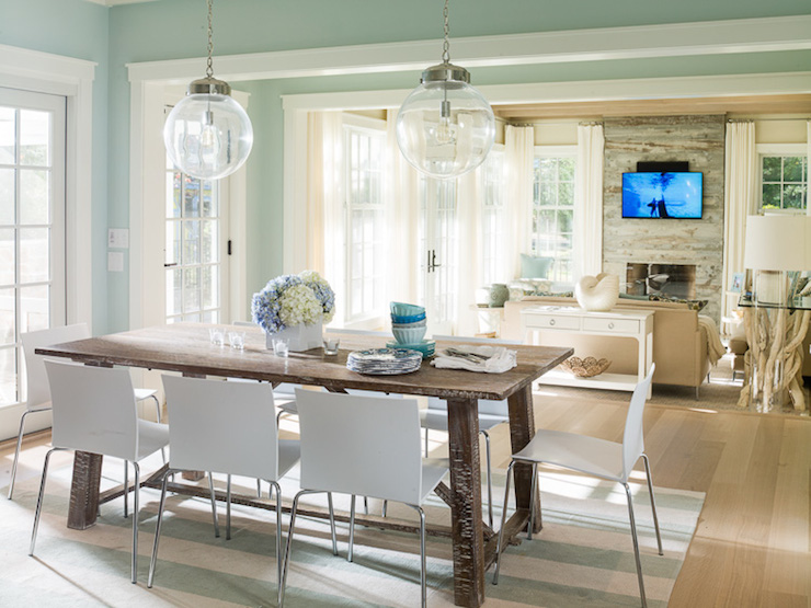 beautiful cottage dining room features a pair of clear glass globe pendants a salvaged wood trestle dining table lined with modern white dining