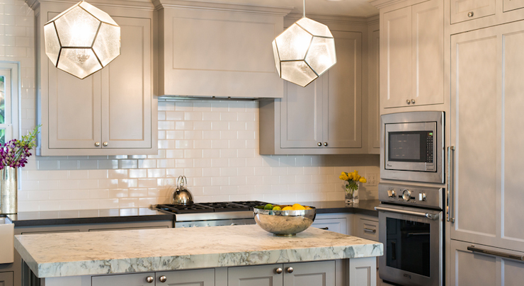 Gray shaker kitchen cabinets with engineered white quartz for Upper end kitchen cabinets
