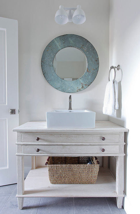 Interior design inspiration photos by space architects - Round mirror over bathroom vanity ...