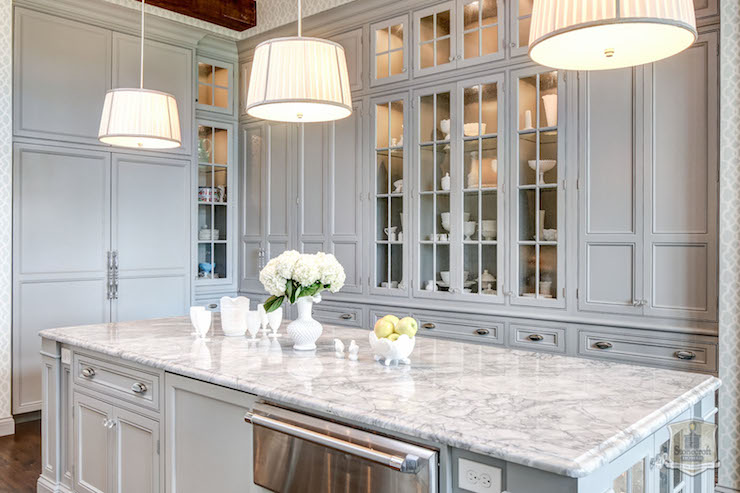 traditional style kitchen features wall to wall gray built in cabinetry framing glass front china cabinets adorned with brushed nickel hardware - Built In Cabinets For Kitchen