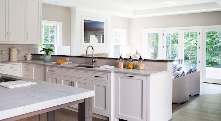 ... Cabinets Paired With A White Quartzite Countertops And A White  Quartzite Slab Backsplash Adjacent To A Kitchen Peninsula Which Is Fitted  With Undermount ...