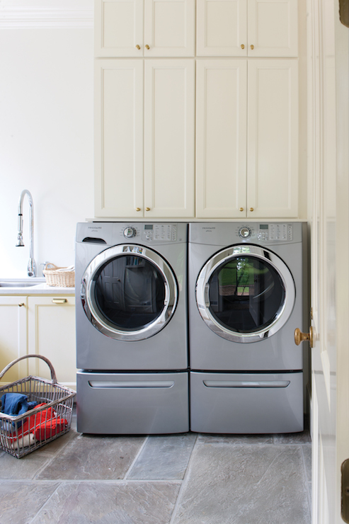 stacked cabinets above washer dryer design decor