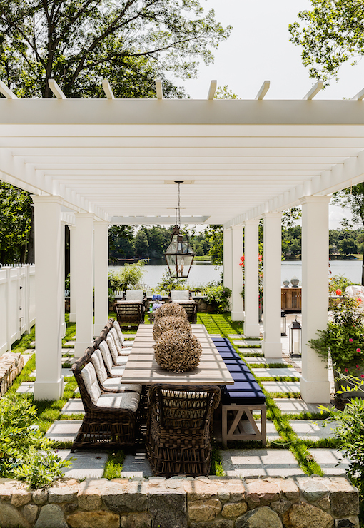 Amazing Dining Pergola Is Dotted With Carriage Lanterns Illuminating A Long Wood Table Lined Wicker Chairs On One Side And