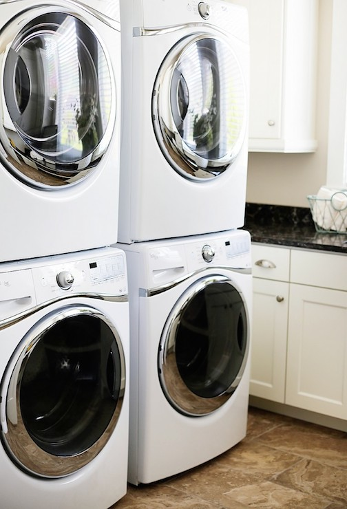 contemporary laundry room with two sets of stacked washers and dryers flanking sink. Black Bedroom Furniture Sets. Home Design Ideas