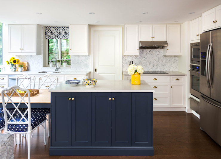white and navy kitchen features white shaker cabinets paired with