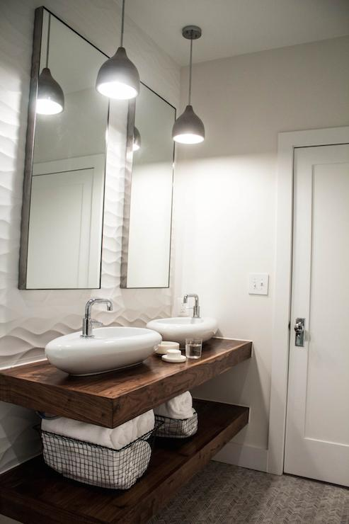 Stunning Bathroom Features A Modern Wooden Floating Sink Vanity Boasting A  Lower Shelf Lined With Wire Towel Baskets Alongside Upper Shelf Mounted  With A ...