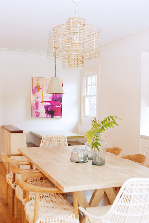 Stunning Dining Room Features A Rectangular Trestle Table Lined With Fox Oak Armchairs And Pair Of White Rattan Host Chairs Illuminated By An