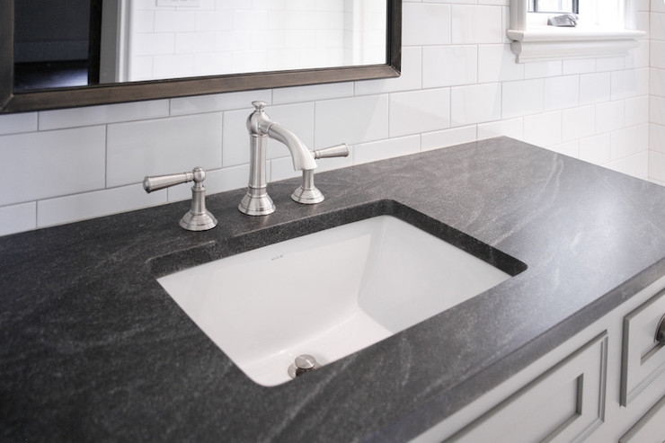 framing a gray vanity topped with Jet Mist Honed Granite countertop ...