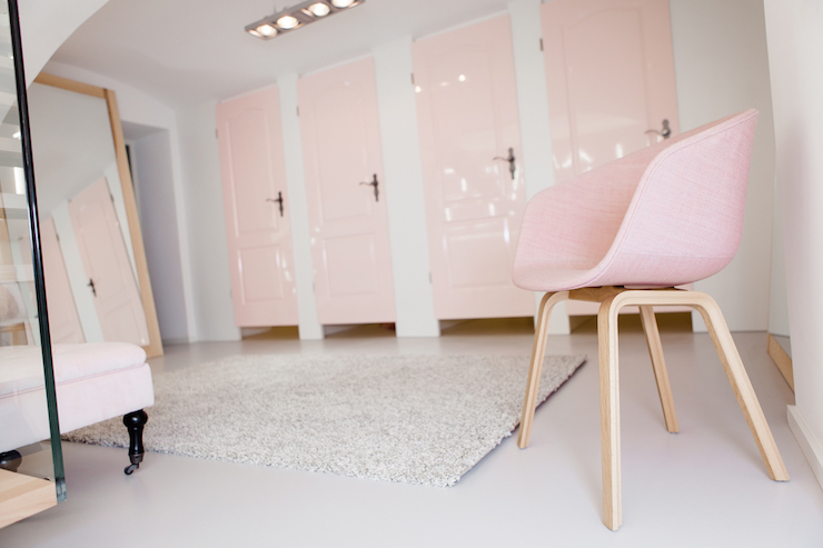 Pink And Gray Bedroom With Pink Door And Gray Tufted
