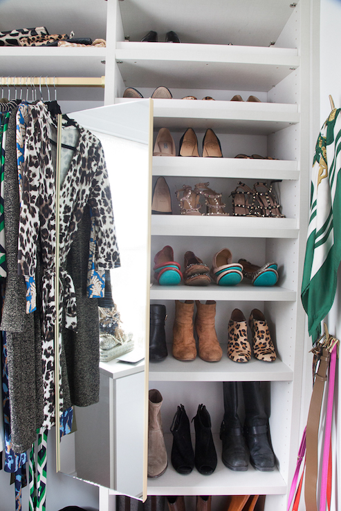 Gorgeous Walk In Closet Features Floor To Ceiling Built Ins Housing  Clothes, Shoes, Clutches And Hand Bags Accented With Pull Out Mirror.