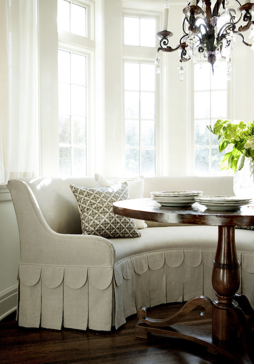 Breakfast Nook Boasts Bay Window Dressed In Cafe Curtains Framing A Curved Banquette With Pleated And Scalloped Skirt Facing Traditional Round Dining
