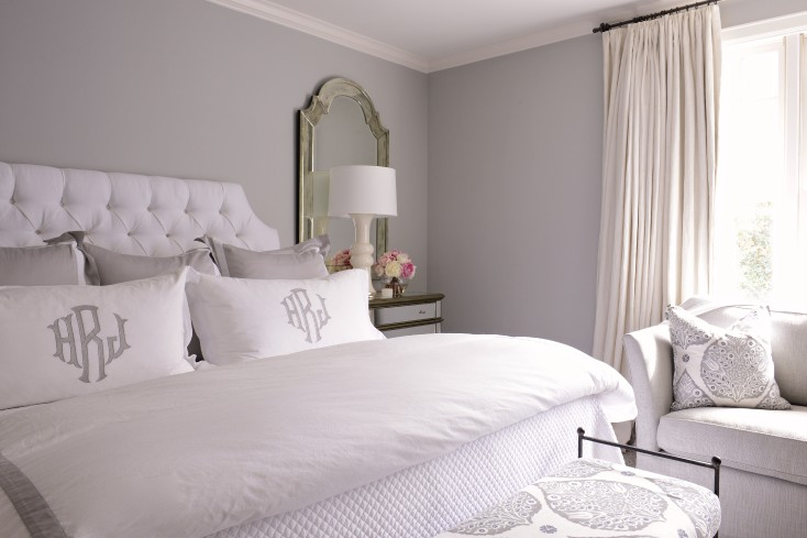 grey master bedroom boasts silver grayw alls lined with white tufted headboard on queen bed dressed in white and gray ribbon bedding and white and gray - White Grey Bedroom