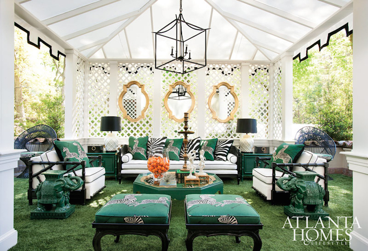 Stunning garden features a tented pergola illuminated by an iron lantern  over a white trellis back wall adorned with three gold arabesque mirrors  above a ...