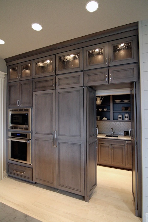 Hidden butlers pantry transitional kitchen for Kitchen wall cupboards