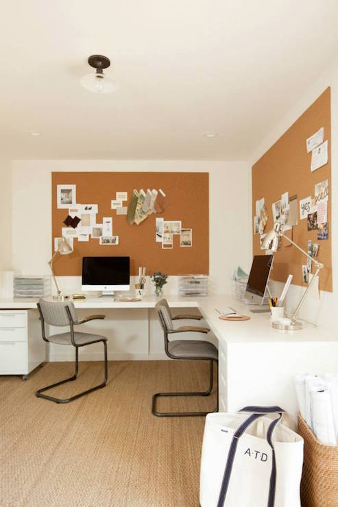 Lovely Office Boasts An Rolling File Cabinets Tucked Under A Built In L Shaped Desk For Two Situated Matching Cork Boards Atop Jute Rug