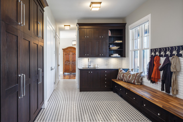Mudroom with dark cabinets transitional laundry room for Mudroom floors