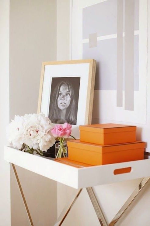 Hallway Boasts A White Lacquered Tray Table Filled With Pops Of Orange,  Stacked Hermes Boxes, Flowers And Kate Moss Photo Under A Purple And Gray  Abstract ...