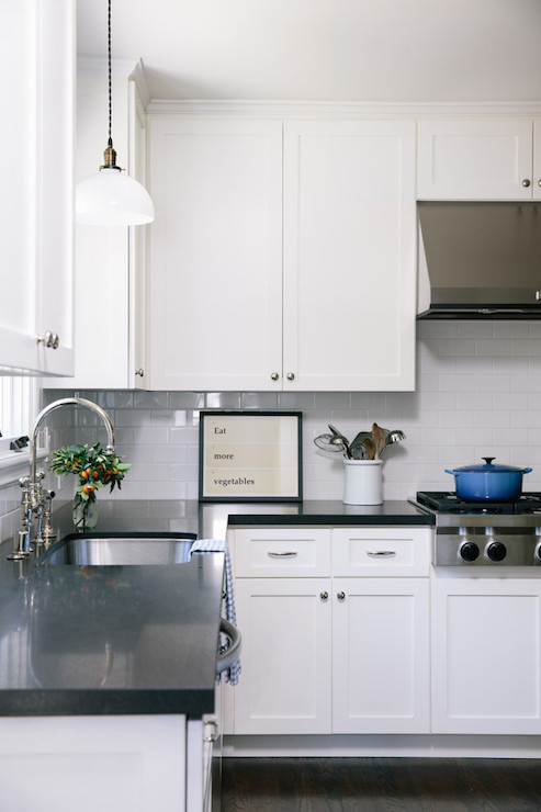 White Kitchen Cabinets With Black Counters Transitional Kitchen