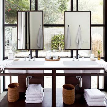 Vanity Mirrors Over Windows