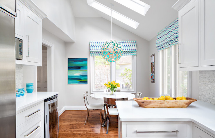 Contemporary breakfast nook boasts a sloped ceiling fitted with two  skylights accented with a David Trubridge Coral 400 Pendant Lamp  illuminating a round  Dining Room Sloped Ceiling Design Ideas. Pendant Lights On Sloped Ceiling. Home Design Ideas