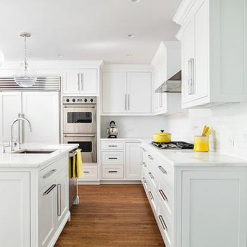 White cabinets with gray center island transitional - Kitchen with yellow accents ...