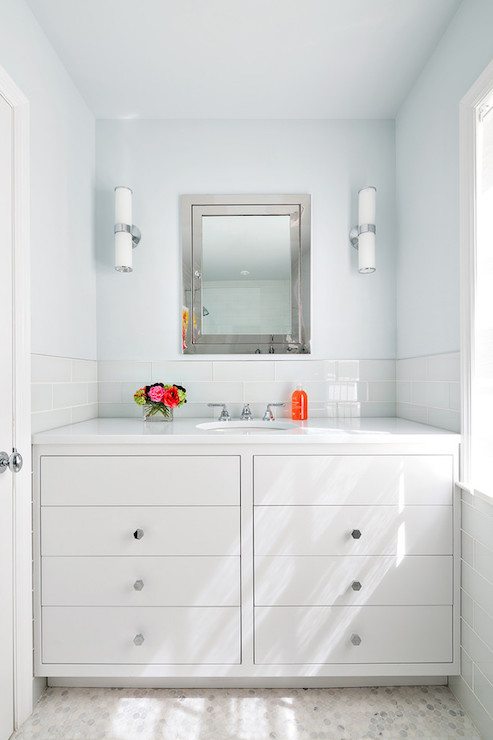 White And Blue Bathroom Features Top Half Of Walls Painted Sky Blue And  Bottom Half Of Walls Tiled In White Glass Brick Tiles Enclosing A White  Lacquered ...